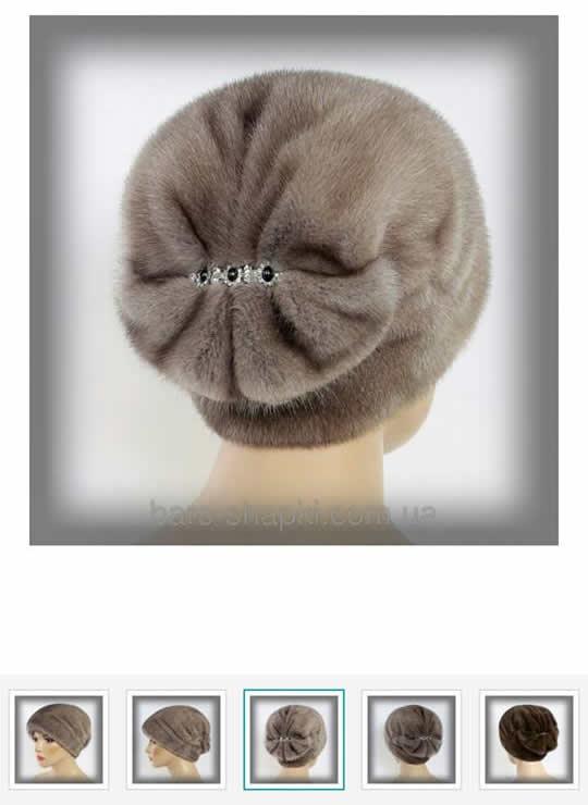меховые женские шапки на выставке